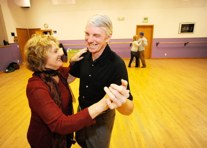 Dance class instructors Charles Horton and Polly Idol share a laugh while dancing Thursday at Northwest Ballet Studio.