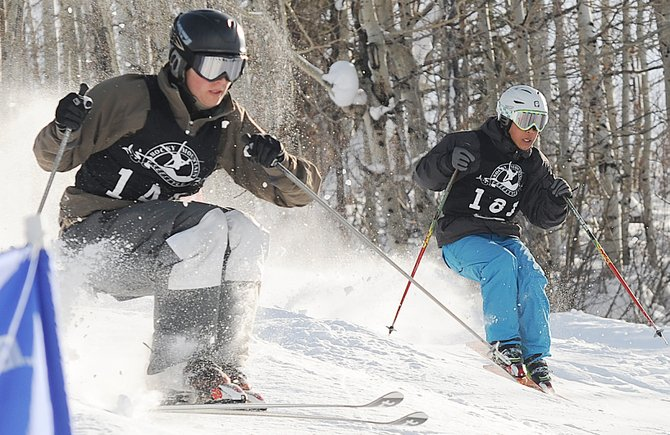 Steamboat Springs skier Bo Randolph, left, flies down the moguls run at the Travis Mayer Competition Venue on Voo Doo run at Steamboat Ski Area. Randolph finished second in the event, even surprising himself after he nearly gave up competitive skiing during the summer.