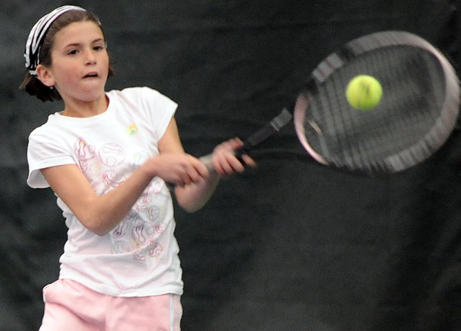Tammy Katthain swings for a return Sunday at the Tennis Center at Steamboat Springs during the Steamboat Springs Mixed Doubles and Juniors Championships.