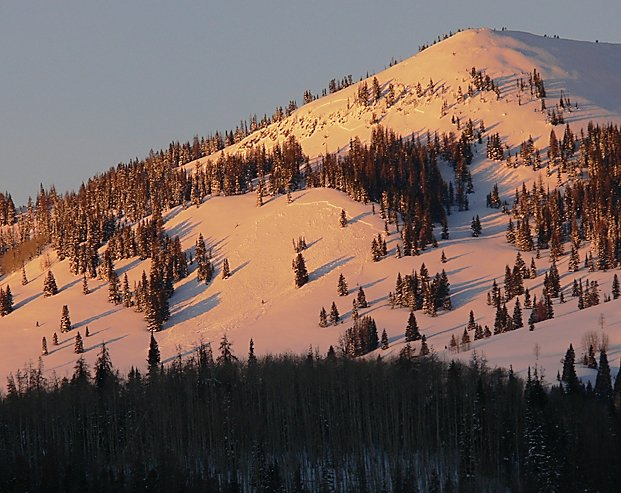 Avalanche expert Art Judson captured a pair of avalanches on the flank of Sand Mountain during the weekend. The lower of the two is the largest — about 200 feet in width. The upper of the two is a little harder to make out in the thin line of trees closest to the bald peak. Both are hard slab avalanches, Judson said.
