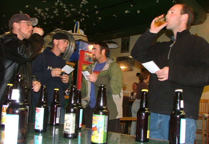 James Kelso, left, Nicolas White, John Balzer and Justin McIntyre sample some amber ales during a beer tasting hosted by Stockmen's Liquors in 2004 at Carelli's Pizzeria and Pasta. The Craig City Council approved a resolution Tuesday night adopting new state requirements for tasting events and establishing an application process.