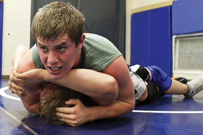 Cody Adams puts a teammate on his back during a standing fast line drill Wednesday at wrestling practice. Adams was one of the MCHS grapplers to take home a first-place finish in Las Vegas.