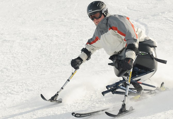 Travis Greene cuts down a run at Steamboat Ski Area on Wednesday during the fifth annual All Mountain Adaptive Ski Camp. Greene was a Marine in Iraq when he lost his leg in an explosion. He had little trouble with the freshly groomed slopes of Mount Werner but struggled at first in the deep powder of Buffalo Pass as campers spent the day with Steamboat Powdercats. He figured that out, too, and in the future hopes to develop adaptive sports opportunities himself.
