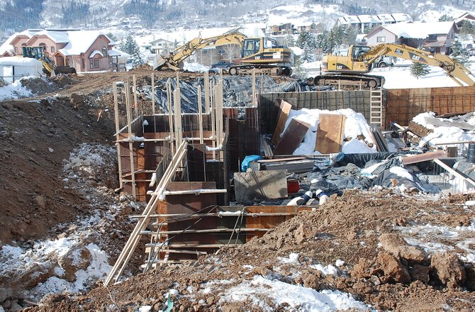 Construction crews put together concrete forms Wednesday for the newest luxury duplex building at The Porches of Steamboat. The city saw permits issued for just 12 duplex buildings and eight single-family homes in 2009.