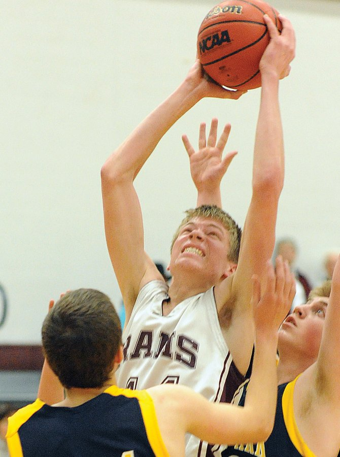 Leif Carlson powers through a pair of North Park defenders Friday night as the Soroco boys basketball team thumped the Wildcats, 49-33.