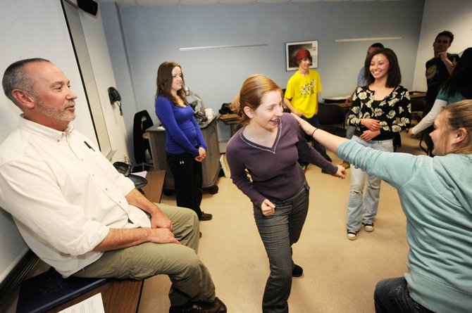 Colorado Mountain College's introduction to acting class instructor Michael Brumbaugh watches Steamboat Springs High School junior Kirsten Delaney tag CMC student Jessica Prudence during a classroom acting exercise Thursday.