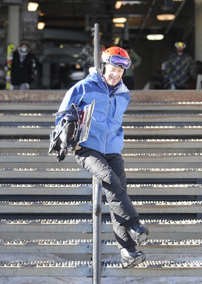 At 74 years old, Steamboat Springs snowboarder Harold Fischel still finds joy in sliding down the railing to the slopes after unloading from the gondola.