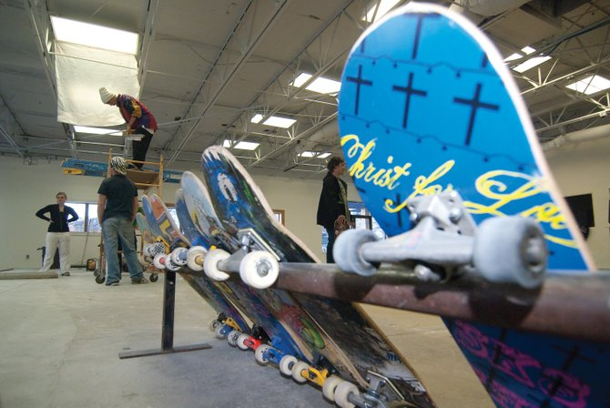 Young volunteers work inside Sk8 Church's new location Wednesday at Riverside Plaza. The church was able to secure the location thanks to an unnamed donor. When finished, the space will provide a place were its young members can meet and skate.