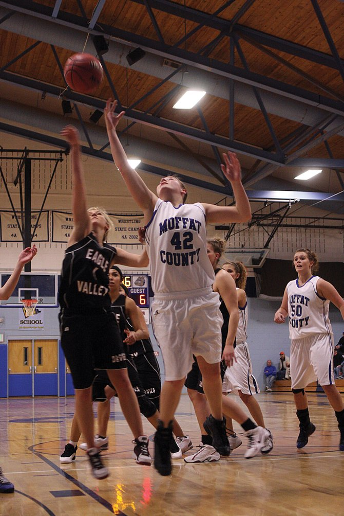 Annie Sadvar, middle, a Moffat County High School sophomore, goes up for a rebound in a Jan. 8 game against Eagle Valley. Sadvar led the Bulldogs on Saturday night in Delta, scoring 18 points in the Bulldogs' 53-49 win against the Panthers.