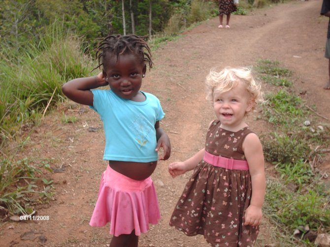 Azariah Aberle, 2, right, smiles as she plays with a new friend on a road in northern Haiti. Azariah's parents, Craig residents Cammie and Sam Aberle, and her brother, Gideon, 4, lived on the island for a year as missionaries. In October 2009, they returned to Craig. On Jan. 12, a 7.0-magnitude earthquake hit an area south of where the Aberles lived.