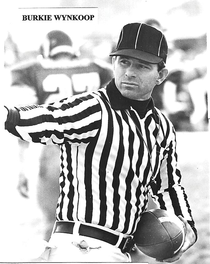 Burkie Wynkoop, above, officiates a game during one of his 21 years patrolling high school and college football fields. Wynkoop, a former Craig resident, was recently inducted into the Colorado Football Officials Association Hall of Fame.