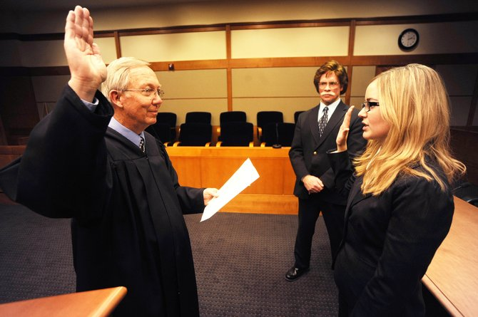 Fourteenth Judicial Deputy District Attorney Rusty Prindle watches as Routt County Judge James Garrecht swears in Jennifer Wunsch to the District Attorney's Office Tuesday at the Routt County Justice Center.