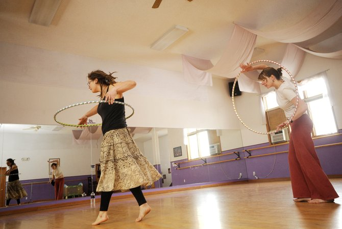Hoop dance instructor Jennifer Harlan, right, dances with Kristin Camire on Wednesday at Oak Street Dance Studio, formerly known as Northwest Ballet Studio. The studio is holding an open house Saturday.