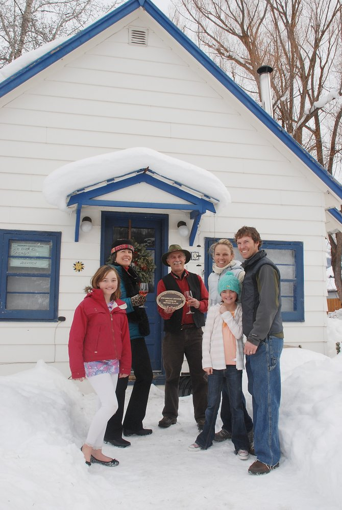 Historic Preservation Advisory Committee members Sally TeStrake, back row, from left, and Johnny Walker celebrate with Kate and Craig Rench the addition of the Rench home to the Steamboat Springs Register of Historic Places. Kensey Bishop and Eli Roach also are pictured.