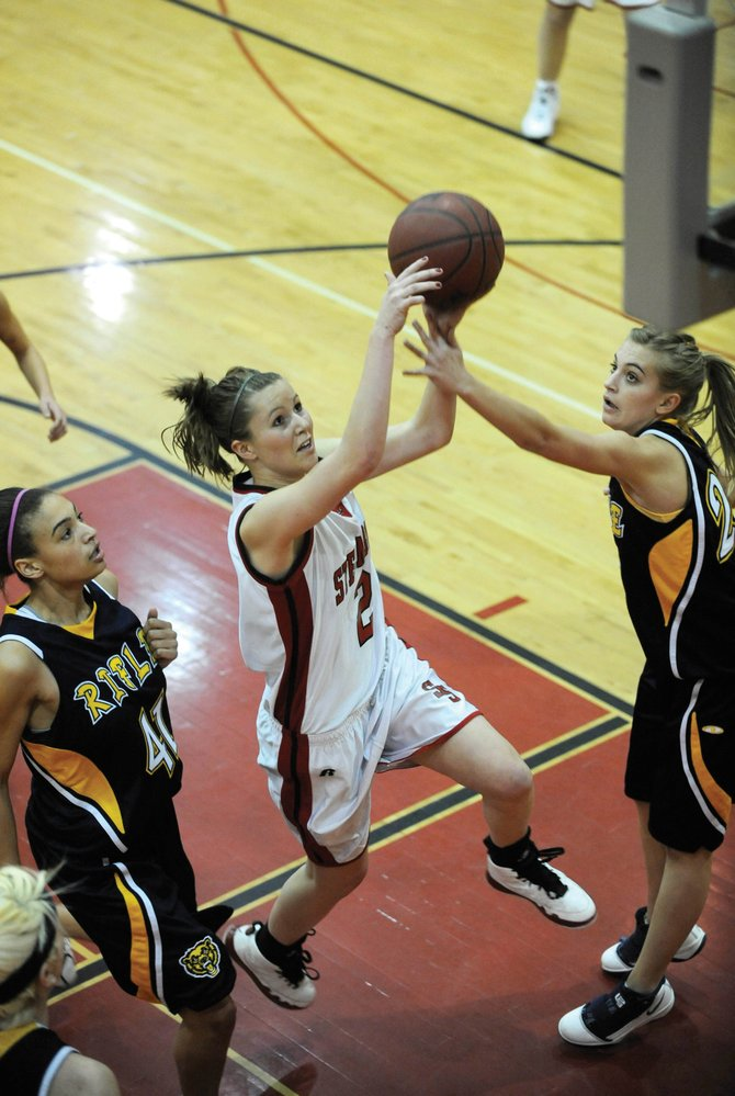 Steamboat Springs High School junior Hannah Moore goes up for a layup during Friday night's game against Rifle High School. The Sailors girls lost, 57-29. The boys team won its game against Rifle, 56-52.