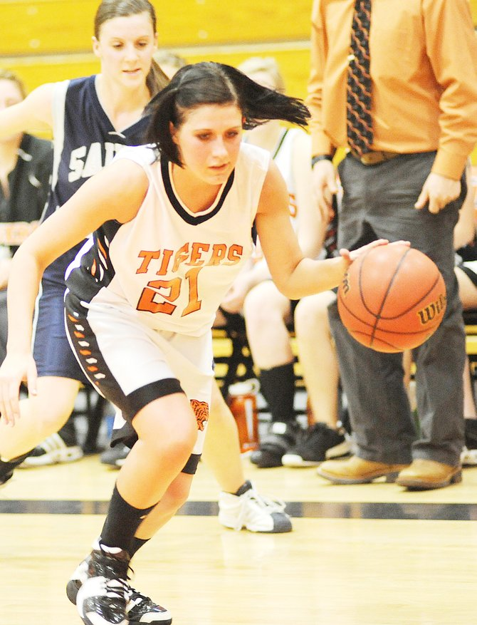 Hayden junior Kyra Roladno flies through the Vail Christian defense Friday night as the Tigers surged early to handle the Saints. Rolando led her team with 18 points.