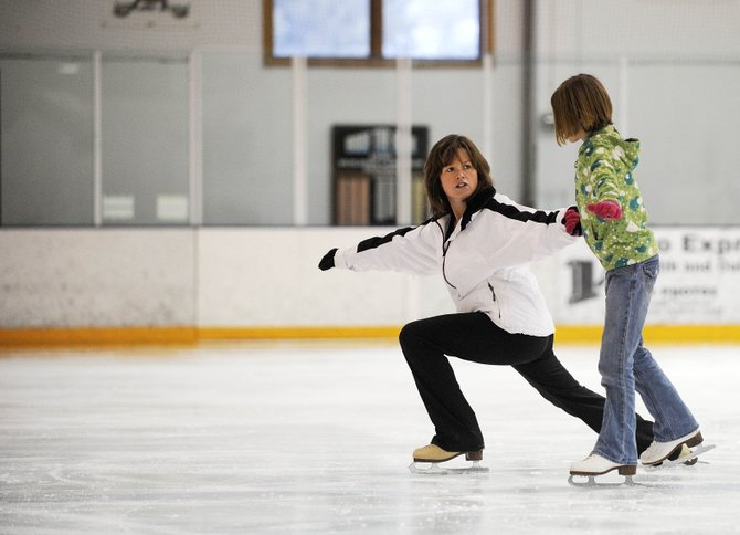 Steamboat Springs resident Kim Haggarty works with Alison Famulare during figure skating practice Thursday at Howelsen Ice Arena. Since winning the $27 million Colorado Lottery in 1992, Kim Haggarty has devoted much of her time to teaching youths how to figure skate.