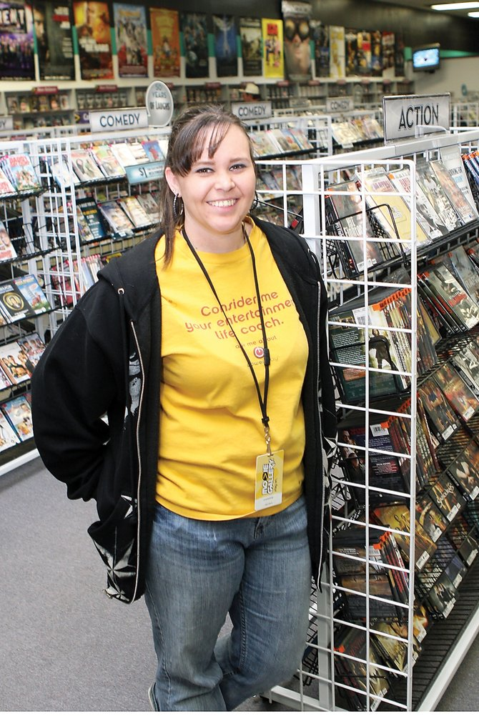 Carrie Lira stands in Movie Gallery in the Centennial Mall. She has worked for the company for 10 months and has been a Craig resident since 1988.