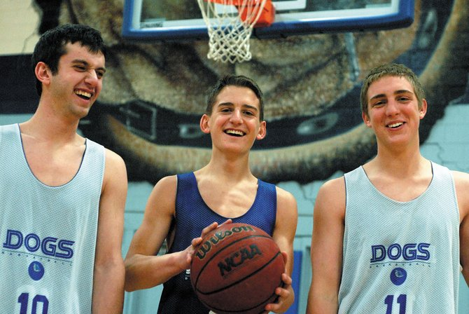 Andrew, from left, Zach and Angelo Raftopoulos have been playing basketball together for as long as they can remember. Brothers Andrew and Zach, along with their cousin, Angelo, play for the Moffat County High School boys varsity basketball team this season.