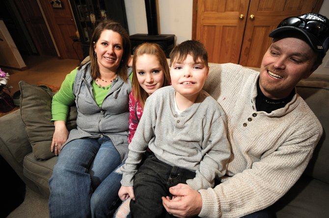 The Tritz family, of Oak Creek, from left, Sorrel, Emilee, Tanner and Chris, are hoping to raise funds for Tanner, who has cerebral palsy, to purchase a device that will allow him to communicate better. Not pictured is Tanners brother, Peyton.