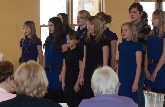 Students from the Christian Heritage School sing to a group of seniors during the Routt County Council on Aging's weekly luncheon Monday afternoon.