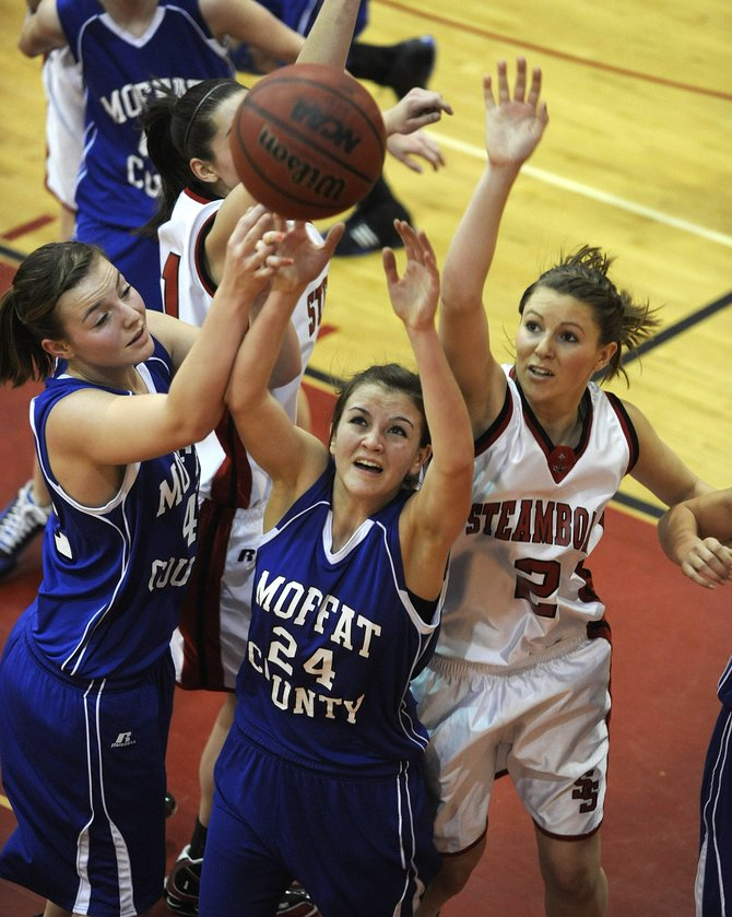 Moffat County High School girls basketball players Annie Sadvar, left, and sophomore Melissa Camilletti, middle, go up for a rebound during Tuesday's game against Steamboat Springs in Steamboat. The Sailors won, 45-34.