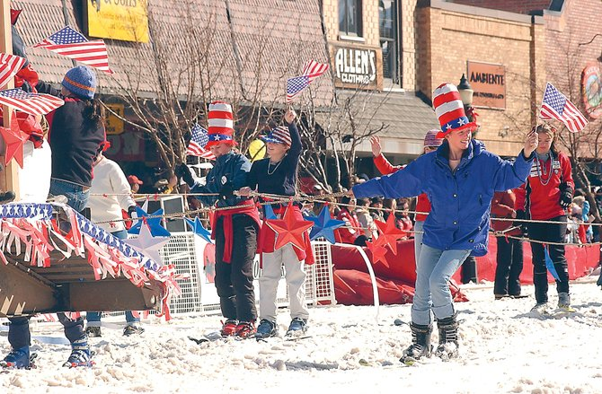 Participants in the Diamond Hitch Parade show their American spirit in red, white and blue.