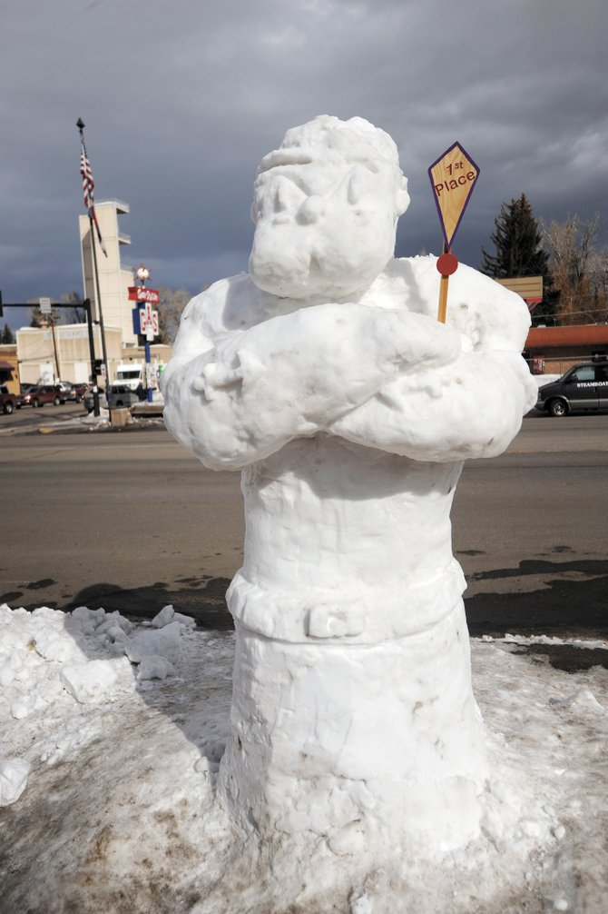 "The ""Popeye"" snow sculpture, by students Abraham Rodriguez, Rogelio Loya, Daniel Delgadillo, Jose Luis and Alan Nunez in Old Town Square won first place in last year's sculpture contest."