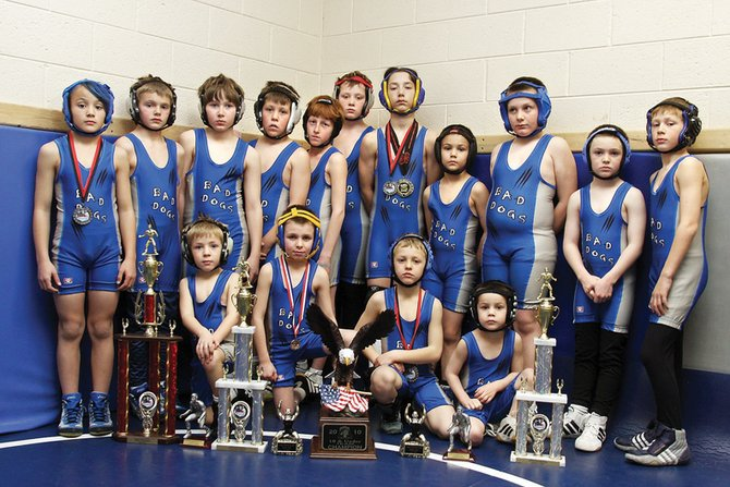 The Craig Bad Dogs had 23 wrestlers place at the Jan. 16 Las Vegas tournament. Fifteen of those wrestlers are pictured above. They are, back row, from left, Ethan Powers, Mathew Moschetti, Mikinzie Klimper, Mikey Bingham, Issik Herod, Deven Mosman, Shandon Hadley, Gregory Hixson, Cody Pleasant, Daniel Caddy and Thomas Baker. Front row, from left, are Cody Baker, Dagan White, Luke Pleasant and Kaden Hixson. The Bad Dogs followed their strong showing in Las Vegas by winning their first national tournament Jan. 23 in Utah.