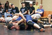 Moffat County's Cody Adams fastens a headlock on Meeker's Collin Cochran moments before a pin 35 seconds into their match Friday in Meeker. Adams placed sixth in last year's regionals and hopes to improve on that to make it to the state tournament this season.