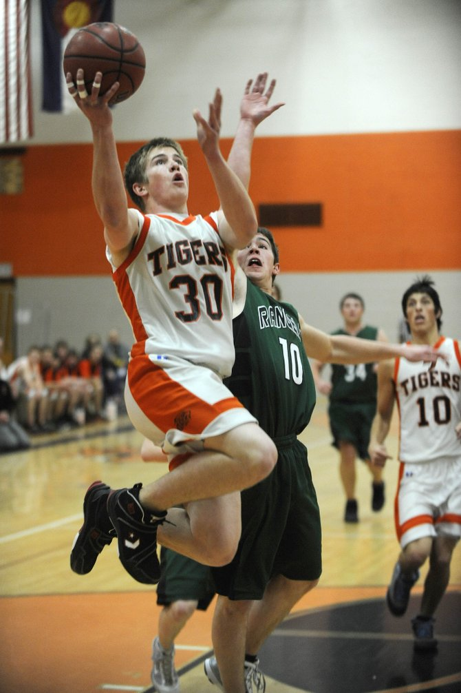 Hayden High School junior Ben Williams goes for a layup during the first half of Saturday night's game against Rangely High School. The boys won, 56-41.