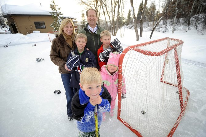 This time of year, members of the McNamara family often can be found playing at their skating rink next to their home on Steamboat Boulevard. Pictured are, clockwise from bottom, Ryan, Grant, Michelle, Blair, Jack and Mia.