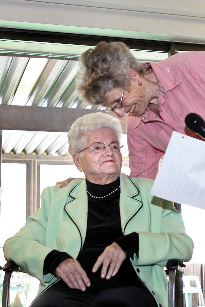 Mary Lou Allen, right, Preserving the Last Frontier president, embraces Verniece Self, 90, during a special event to honor members 90 years or older Saturday at Sunset Meadows I.