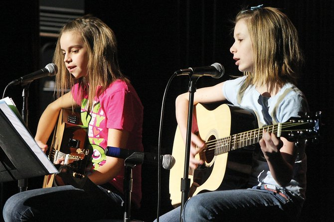 "Pearl Wyman, 10, left, and Elizabeth Weiss, 11, play the old Guns N' Roses hit song, ""Sweet Child O' Mine,"" during Saturday's audition at the Moffat County High School auditorium for the upcoming Local Talent Concert. Craig residents showcased their skills to find a place in the lineup for the Talent Concert, which is put on by the Craig Concert Association."