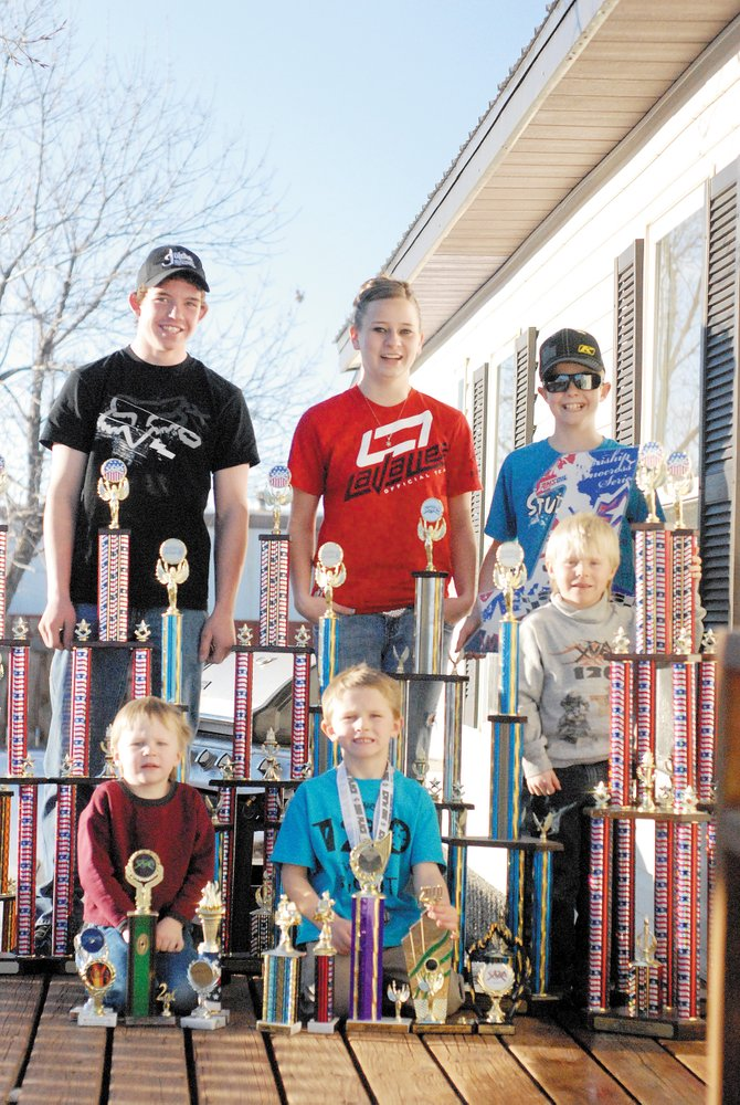 Members of the XMR snowmobile racing team will compete Feb. 13 and 14 at the Wyman Winter Festival. The team is, back row from left, Maury Chapman, Michelle Stoffle and AJ Stoffle. Front row, from left, are Luke Montgomery, Tallyn Wagner and Logan Montgomery.