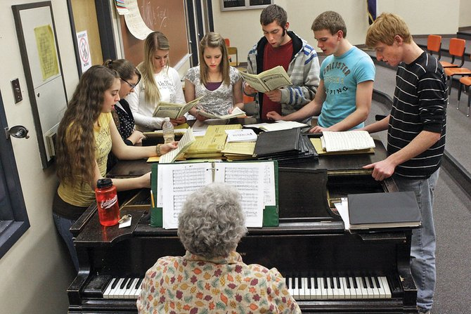 Julia Foster, shown playing the piano, leads a group of Moffat County High School jazz choir students through a singing exercise Tuesday in the school's music room. Five of the choir's members will participate in the Colorado All State Choir this weekend.