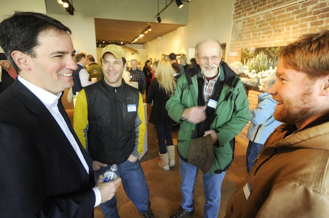 U.S. Senate candidate Andrew Romanoff, left, visits with supporters, from right, Ben Beall, Joe Roberts and Kenny Reisman on Tuesday during a meet and greet at the Artists' Gallery of Steamboat. Beall's father, also named Ben Beall, is a former county commissioner.
