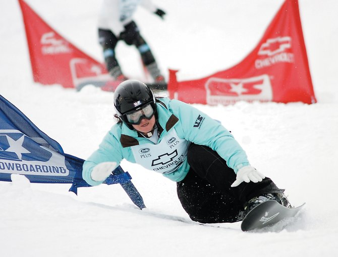 Former Steamboat Springs Winter Sports Club and member of the 2010 U.S. Snowboarding Team Michelle Gorgone races through a gate during a Race to the Cup parallel slalom event at Howelsen Hill.