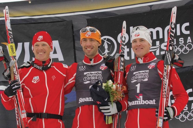 Johnny Spillane, middle, stands on the podium  after winning the 2010 U.S. Winter Olympic Team Trials Nordic combined race at Howelsen Hill. Second-place finisher Todd Lodwick, left, and third-place finisher Billy Demong, right, and Spillane will represent Steamboat Springs at the Olympics on the U.S. Nordic Combined Ski  Team.