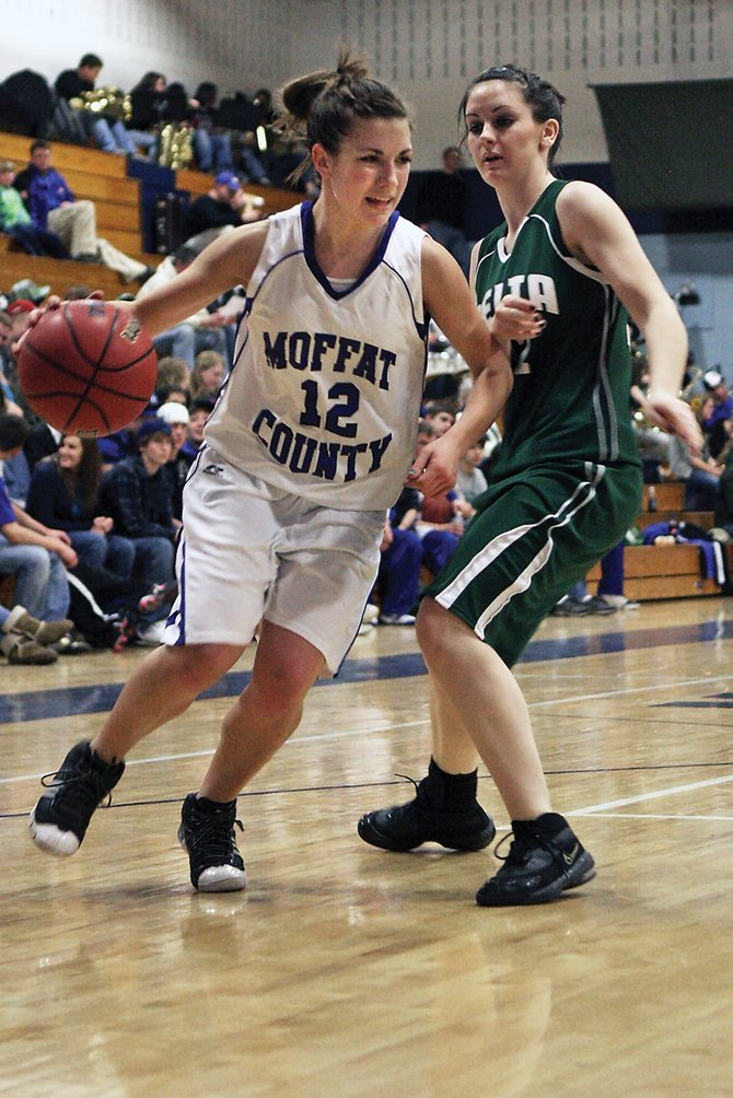 Junior Justine Hathhorn, left, drives to the baseline during the girls varsity basketball game Friday night at Moffat County High School. The Bulldogs beat the Delta High School Panthers, 55-24.