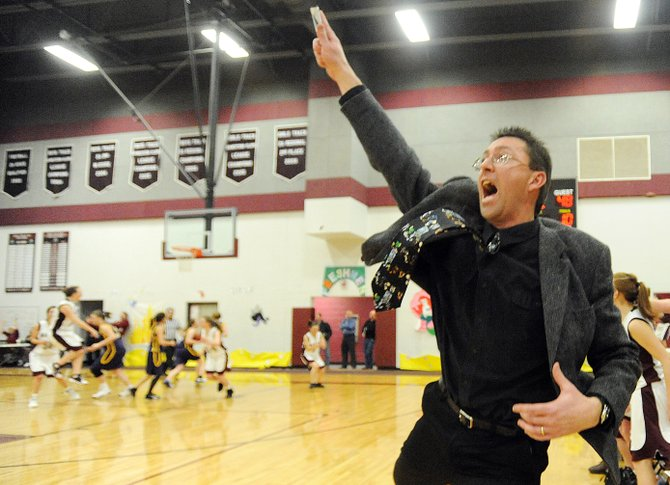 Soroco girls basketball coach David Bruner reacts after sophomore Madison George hit a layup to give the Rams a 50-48 victory in the Feb. 6, 2010, game against West Grand. Bruner will return to coach the girls basketball team after stepping down at the end of last season.