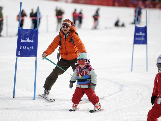 Steamboat Springs Winter Sports Club Alpine Director Deb Armstrong guides her 2-year-old daughter Adelyn through the Soda Pop Slalom course Friday at Steamboat Ski Area.