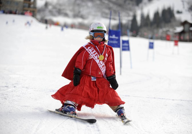 Steamboat Springs Winter Carnival princess Tinsley Wilkinson, 5, participates in the Soda Pop Slalom on Friday at the Steamboat Ski Area.