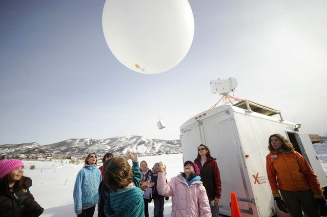 Soda Creek Elementary School fifth-graders launch a weather balloon Wednesday from the Steamboat Barn Village subdivision.