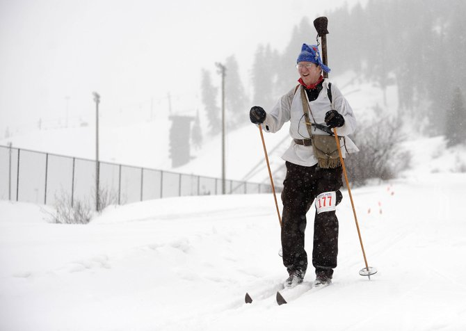 International Muzzle Loading Biathlon participant Bob Brassell finishes his first lap of skiing during Saturday's competition at Howelsen Hill. The street events continue today on Lincoln Avenue with children participating in events including the ring and spear race, obstacle course and street slalom.