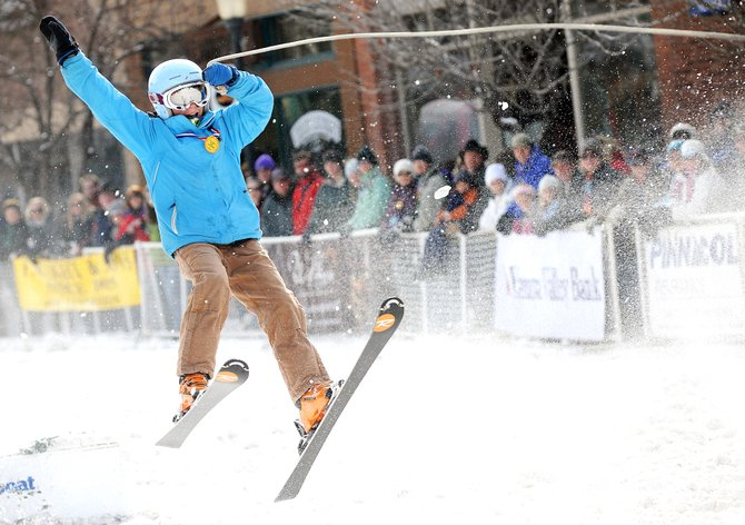 Paula Cooper, 11, of Steamboat Springs, flies off the donkey jump during the 97th annual Winter Carnival street events Sunday in downtown Steamboat Springs.