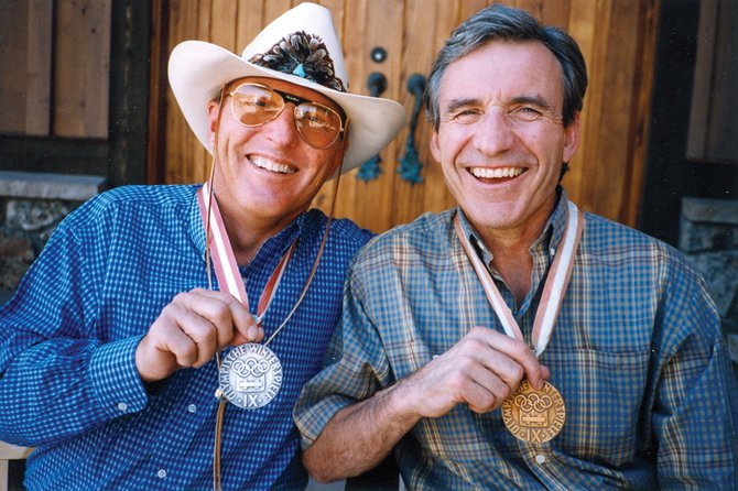 1964 Olympic medalists and pals Billy Kidd, left, and Jimmie Heuga pose with their prized hardware. They were the first American men to win Alpine ski medals. Heuga died Monday in Louisville, Colo.