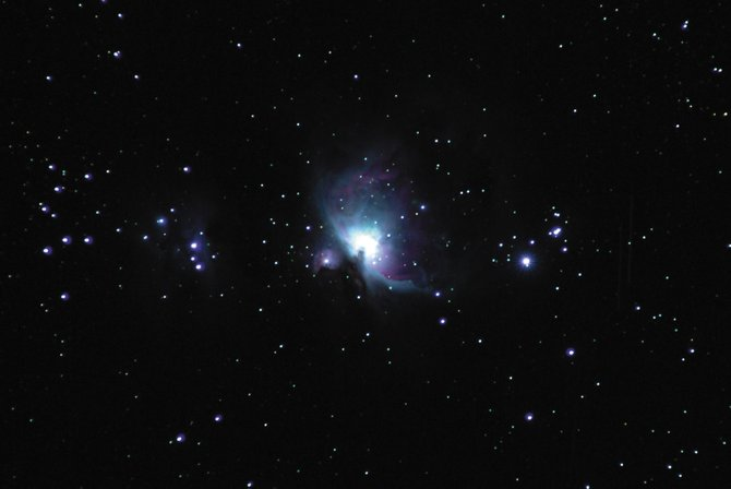 Below the three stars of Orion's belt is his sword, also marked by three fainter stars. What the unaided eye sees as the fuzzy middle star of the sword actually is the Great Orion Nebula, shown in this telescopic time-exposure image.