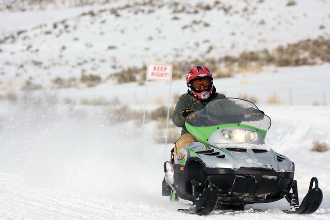 "Bob Lipes rides his snowmobile during January's Poker Run at the Elkhead Reservoir trailhead. Recreational snowmobiling in Craig will be the focus of BAM Film Productions' ""Sledding the West,"" which will be filmed this weekend."