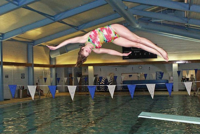 Genna Bradley practices her one-and-a-half front with a twist dive Tuesday at the Moffat County High School swimming pool. Bradley will make her fourth trip to the Colorado state swim meet this weekend.